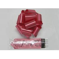 China Bright Red Poly Pom Pom Bow with Solid ribbon for wedding decoration and celebration wholesale