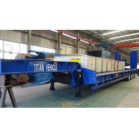 China TITAN 3/4/6 axles 40/60/80 tons machine carrier port engine low flat bed trailer on sale