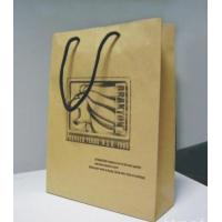 China 200gms Brown Kraft Paper t-Shirt Bags For Shopping With Customized Logo / Brand,Pp Handle wholesale