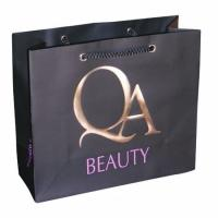China Gold Stamping 157gsm Black Personalized Paper Bag, Cosmetic Packaging Bags on sale