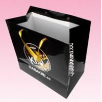 China custom paper bag supplier with gold stamping logo gold satin ribbon handle on sale