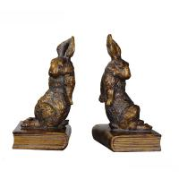 China Pushing Bunny Home Decor Bookends Brass Rabbit Figurine Standing On Book Base wholesale