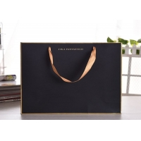 China Luxury gift kraftpaper bag with silk ribbon handle wholesale