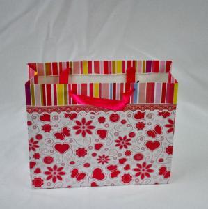 China Ribbon Handle Custom Paper Bags , Eco-friendly Flowery Kraft Paper Bag wholesale