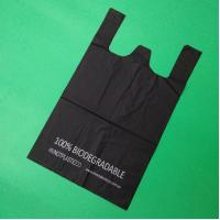 China 100% biodegradable and compostable Starch T-shirt bag, black color, size 0.025mm x (30+15)x50cm, withstand 5kg wholesale