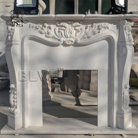 China Solid Hand Carved Marble Fireplace Mantel Freestanding Fireproof Stone For Home wholesale