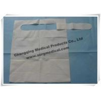 China Waterproof Dental Bibs 3 Layer / Disposable Paper Bibs With Pocket wholesale