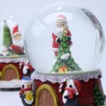 China Christmas music resin christmas snowman snow globe water globe snow ball wholesale
