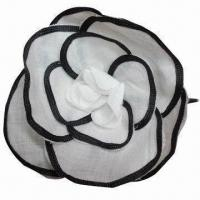 China Flower brooch, made of fabric, comes in white and black color combo wholesale