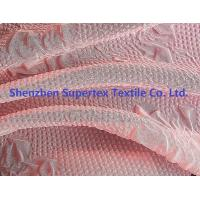 China 50D 75D Polyester Chiffon Fabric Pink Color Embossed Flowers Women'S Clothing Fabric wholesale