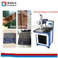 China Laser Tube Co2 Laser Marking Machine 10W/30w For Leather Cloth / Organic Glass wholesale