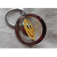 China Color Silver Key Chain Personalized Promotional Gifts With Rotatable Smiling Yellow Face wholesale
