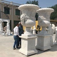 China Large Marble Flowerpot Roman Relief Planters Hand Carved Garden Decoration wholesale