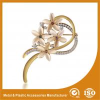 China Decorative Handmade Gold Brooches For Dresses With Crystal Stones wholesale