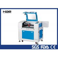 China Economic Tabletop Laser Engraver , Laser Engraving And Cutting Machine For Leather on sale