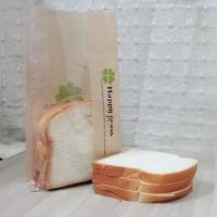 China Stand Up Packing Food Customized Kraft Paper Bags Clear Window For Bread wholesale