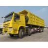 Buy cheap SINOTRUK Howo 8×4 isuzu dump truck  70 Tons Load 30CBM dump box  Model ZZ3317N4667A from wholesalers