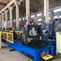 China Cold Metal C Purlin Steel Frame C Profile Roll Forming Machine With Chain Drive on sale