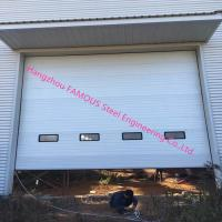 China Full Vertical Lift Door Motorized Industrial Garage Doors With Transparent Windows And Pedestrian Access wholesale