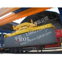 Rotating container spreader